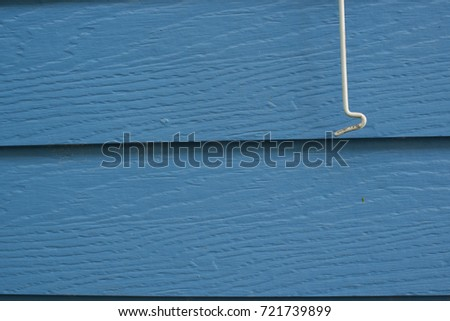 hook on blue wood plank panel texture background #721739899