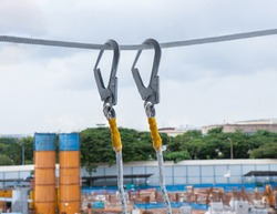 Hook safety harness at construction site background