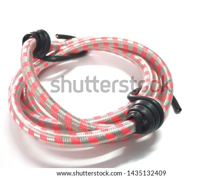 Hooks and elastic straps ropes isolated on white background. Roll of rubber band springy flexible.Colorful rubber band.