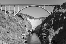 Hoover Dam bypass bridge black and white in Nevada's Mojave desert.