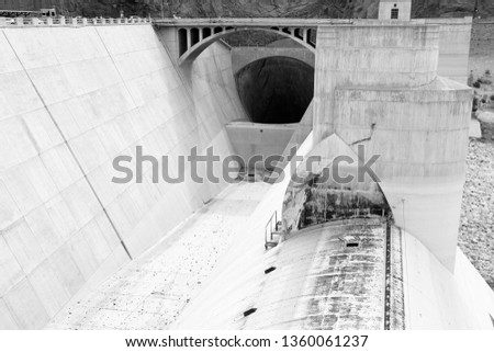 Hoover Dam in United States. Famous hydroelectric power station on the border of Arizona and Nevada. Black and white vintage style.