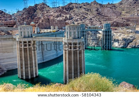 Hoover Dam, is a popular tourist destination and was once known as Boulder Dam, is a concrete arch-gravity dam in the Black Canyon of the Colorado River.