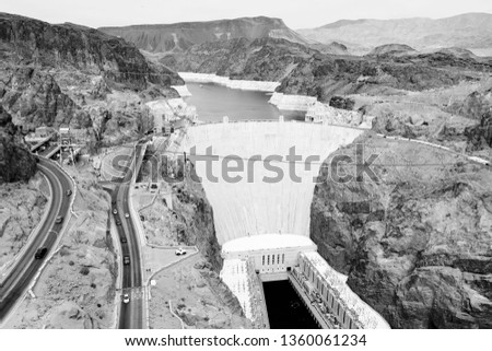 Hoover Dam USA. Hydroelectric power station on the border of Arizona and Nevada. Black and white vintage style.