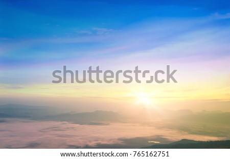 Hope concept: Celestial mountain landscape and sky sunrise background. Nok Ann cliff, Phu Kradueng National Park, Loei, Thailand, Asia #765162751