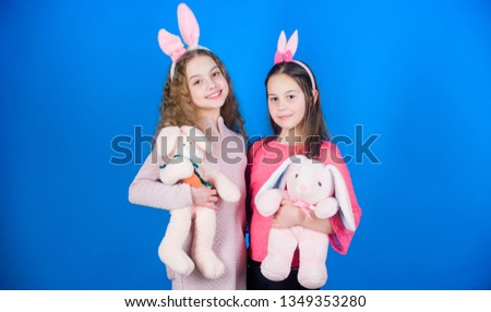 Hope love and joyful living. Children with bunny toys on blue background. Sisters smiling cute bunny costumes. Spread joy and happiness around. Friends little girls with bunny ears celebrate Easter. #1349353280