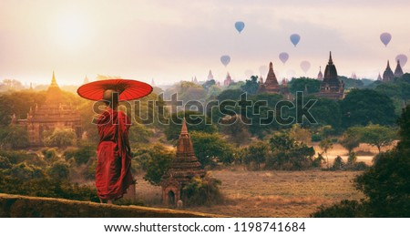 Hope of Bagan Novice monk standing watch old pagoda in morning time in Bagan Mandalay Myanmar.