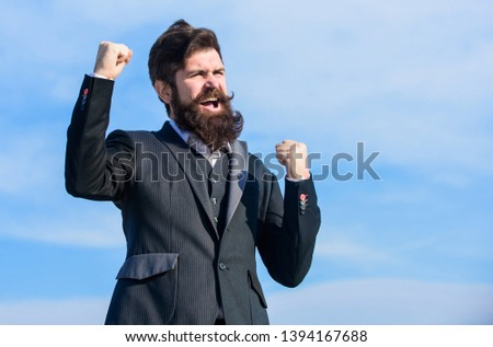Hopeful and confident about future. Man bearded optimistic businessman wear formal suit sky background. Success and luck. Optimistic mood. Think like optimist. Being optimistic. Celebrate success.