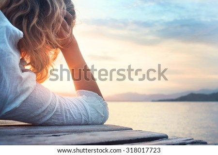 hopeful woman observing the sunset