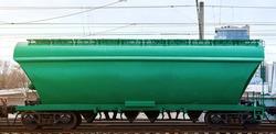 Hopper wagon, freight railroad hopper car.Transportation grain cargo on railway. Railroad grain hopper platform on track.