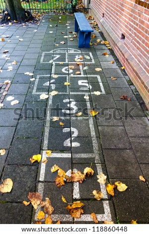 Hopscotch on the schoolyard in the autumn - stock photo