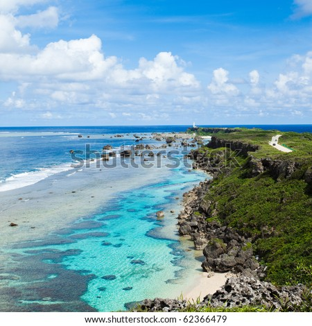 Horizon over clear blue sea with coral reef around tropical island, Miyako Island, Okinawa, Japan - stock photo