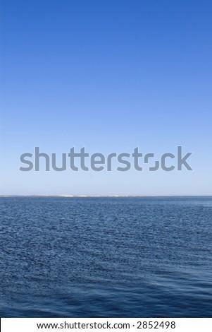 horizon over water on bright summer day  (portrait orientation)