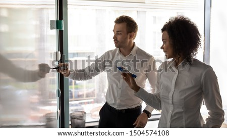 Horizontal banner african woman european man writing on white board presentation in board room, diverse entrepreneurs noting points, describe issues, creating business plan at group meeting in office
