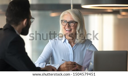Horizontal banner aged 60s ceo met with company client diverse businesspeople negotiating seated at boardroom desk, job interview process good first impression, human resources and recruiting concept