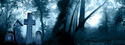 Horizontal banner with night nature scene. Mysterious landscape with Halloween scene with medieval stone crosses, tombstones in a cemetery in foggy forest. Photo toned in blue color