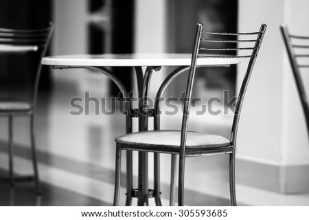 Horizontal black and white business chairs bokeh background
