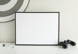 Horizontal, black empty frame mockup to display artwork, game room interior, monochrome style, framed art mockup.