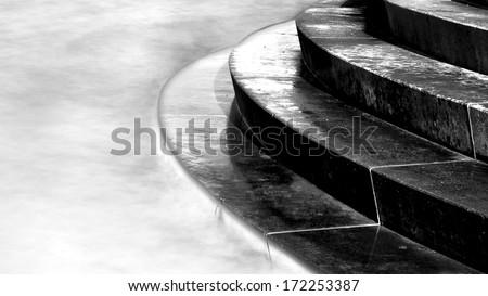Horizontal black & white image of steps leading into sea, Portobello, Edinburgh, Scotland
