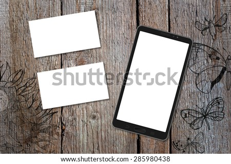 Horizontal business card and smart phone (16:9 screen) mockup with wood deck background. Card is 50x90mm. Wood deck have doodle pictures with sunflowers and butterflies.
