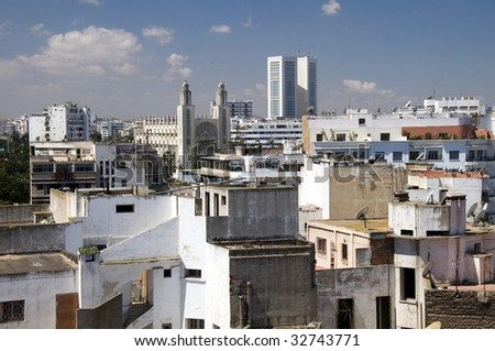 horizontal city skyline view of casablanca morocco with skyscrapers and a mosque with two minarets in africa