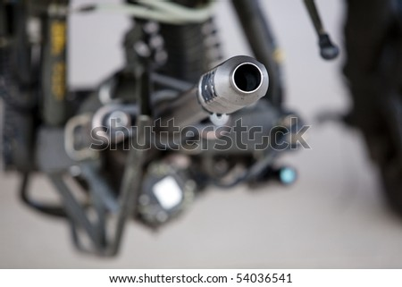 Horizontal close up image of an M230 Chain Gun 30mm auto cannon on an AH-64 Apache helecopter.