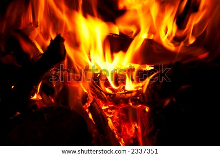 Horizontal close-up of flames and fire on a black background