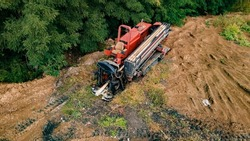 Horizontal directional drilling technology. Aerial view of Drilling machine work process. Trenchless laying of communications, pipes and water pipes. Selective focus