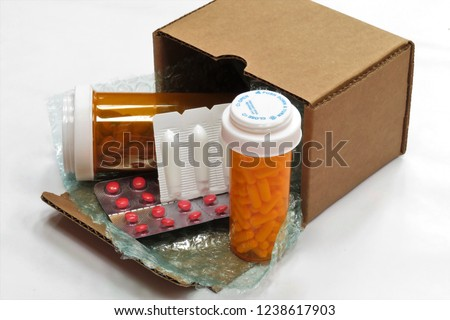 Horizontal image of a box of compounded prescription medications shipped from a mail order pharmacy (with a white background). #1238617903