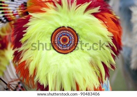 Horizontal image of a feather bustle with detailed beadwork at an American Indian Pow Wow.