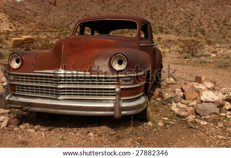 Horizontal Image of a Rusted Out Old Americian Classic Vehicle - stock photo
