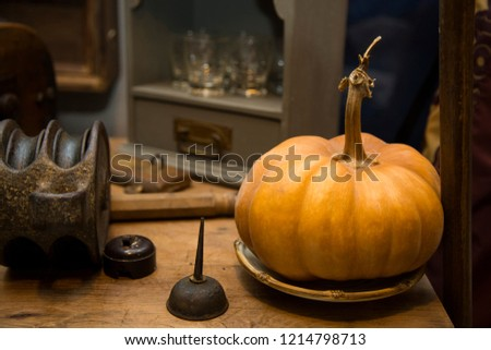 horizontal image of an orange round pumpkin over an old table #1214798713