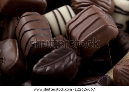 Horizontal image of assorted chocolates in different shapes and size