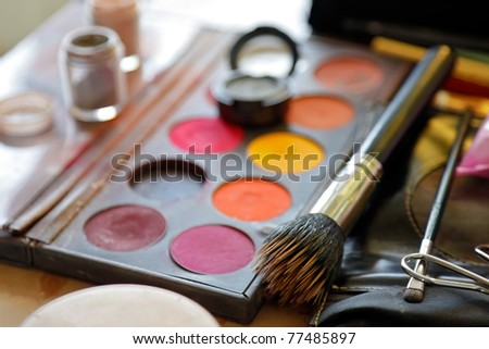 Horizontal image of eye shadow and brush.