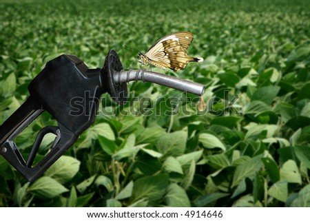 horizontal image of gas nozzle with butterfly - stock photo
