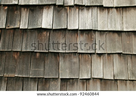horizontal image of gray wooden shake roof for background texture