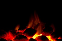 Horizontal image of hot charcoal fire ready for barbecue with black copy-space