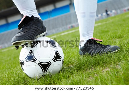 Horizontal image of soccer ball with foot of player touching it