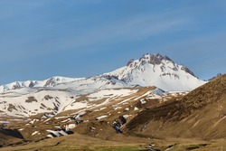 Horizontal landscape of snow covered peak of Erjiyes mountain and ski resort in spring with some snow melting