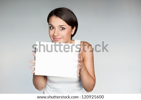 horizontal natural light portrait of young attractive brown-eyed caucasian female with dark hair which dressed in casual outfit.