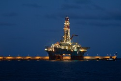 horizontal oil drilling platform at night in Canary Islands
