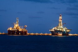 horizontal oil drilling platforms at night in Canary Islands