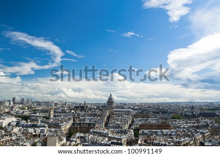 Horizontal panorama of the top view of one of the towers of Notre Dame in a usual summer day. In the background is seen Pantheon of Paris.
