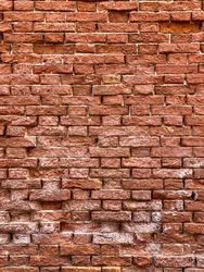 Horizontal part of a Venetian old red brick wall, background,