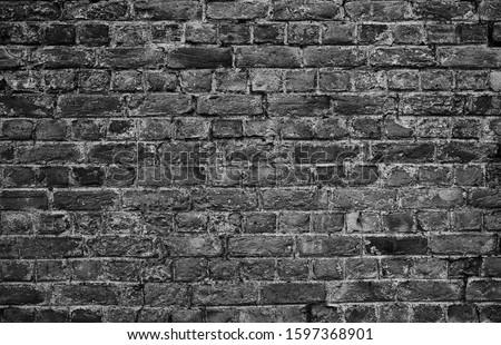 horizontal part of black painted brick wall Stockfoto ©