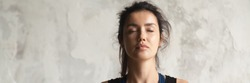 Horizontal photo beautiful woman face with closed eyes practicing yoga breath meditate feels calmness. Physical and mental healthcare concept, banner for website header design with copy space for text