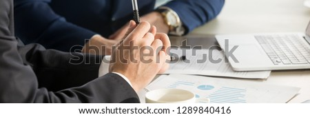 Horizontal photo businessmen during meeting brainstorm negotiate use charts graphs sales analyse stats shown at paper document share thoughts ideas. Teamwork concept, banner for website header design