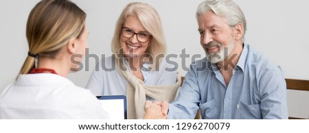 Horizontal photo grey-haired couple aged family meet with real estate agent in office greeting make deal shake hands buy home, leasing bank insurance services concept, banner for website header design