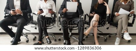 Horizontal photo multinational applicants sitting in row wait in queue prepare for interview businesspeople use gadgets read resume, human resources job search concept banner for website header design