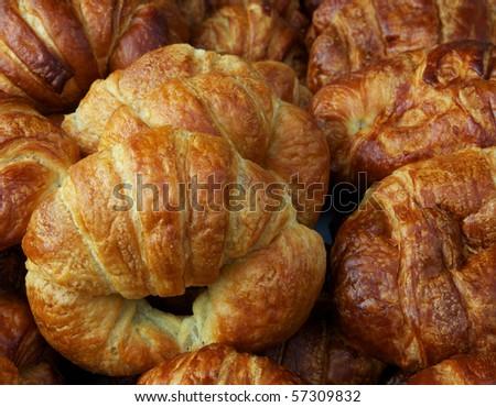 Horizontal photo of group of fresh croissants