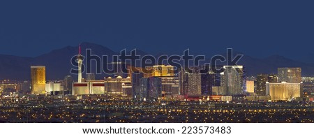 Horizontal photo of Las Vegas with mountain backdrop at night. #223573483